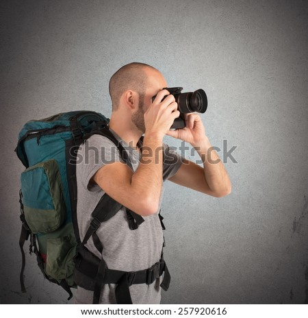 Explorer photographing landscapes visited with his camera - stock photo