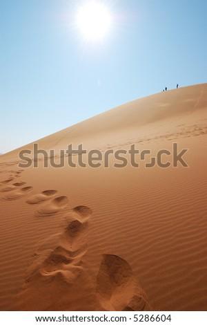 Explorer the Red dune in the Desert - stock photo