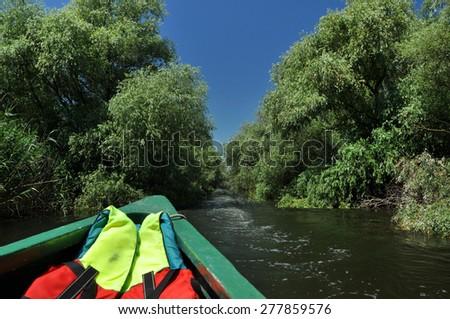 Exploring Danube delta with a boat - stock photo
