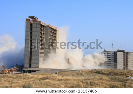Explosion demolishing a city building of an old building - stock photo