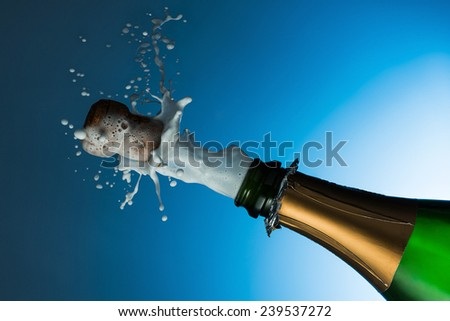 explosion of champagne bottle - stock photo