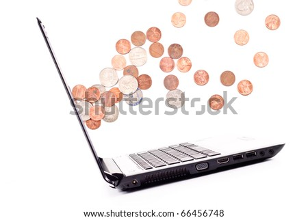Explosion of Coins From Computer Screen - stock photo