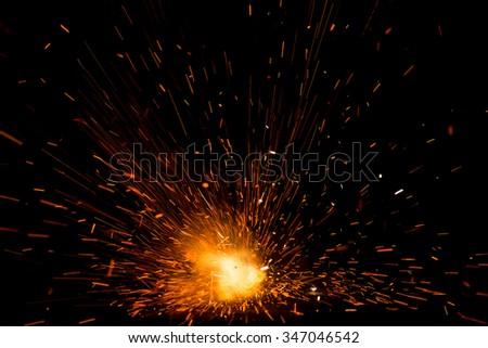 Explosion of firework cracker for bokeh background effect - stock photo