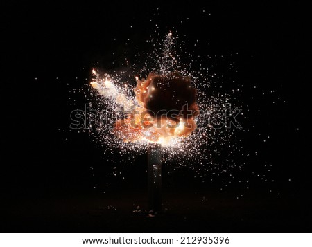explosion over a black background - stock photo