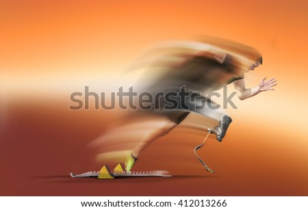 Explosive motion blurred start of an handicapped athlete out of the blocks with glowing running blades . - stock photo