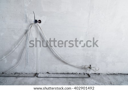 Exposed electrical wall sockets with the top covers removed for installation of the wiring for new apartment. - stock photo