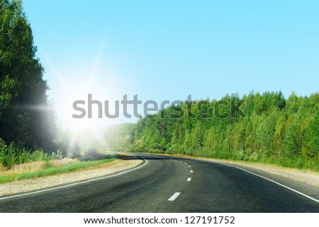 Express road disappearing over the horizon to the sun - stock photo