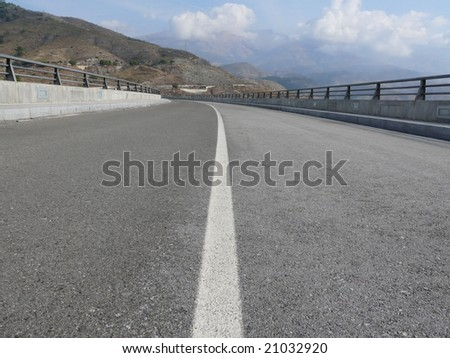 Express road seen from the asphalt level - stock photo