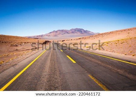 Express Route 27 in the Atacama desert, Chile. The Atacama Desert is a plateau in South America, covering a 1,000-kilometre (600 mi) strip of land on the Pacific coast, west of the Andes mountains. - stock photo