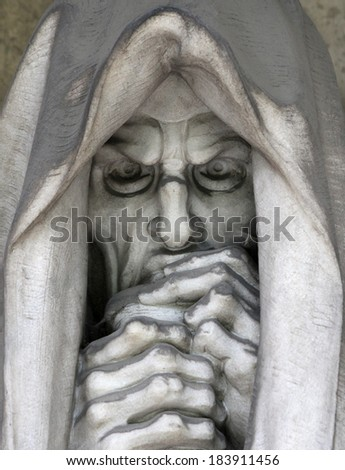 Expressed in the old cemetery tombstone statue grief. - stock photo
