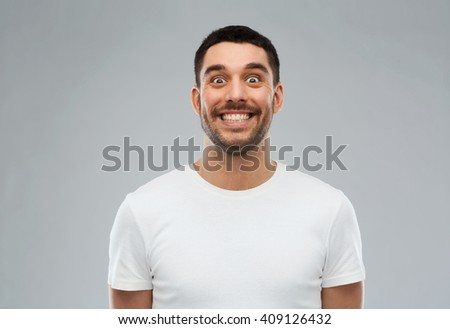 expression and people concept - man with funny face over gray background - stock photo