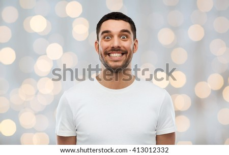 expression, emotions and people concept - man with funny face over holidays lights background - stock photo