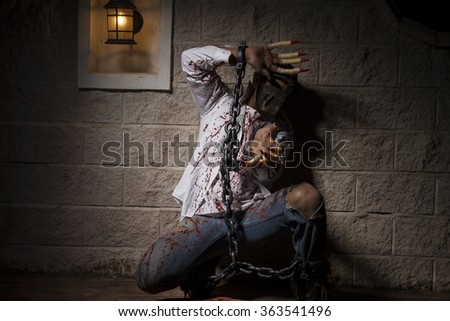 expression, halloween monster chained with bloody hook, night scene and terror - stock photo
