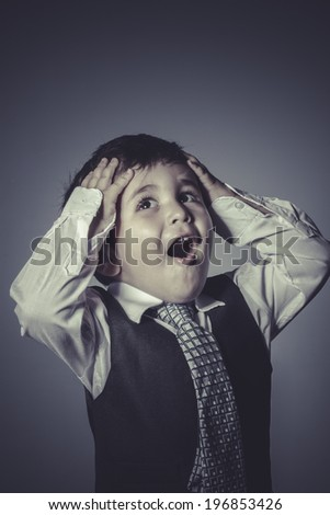 expression, little business boy over grey background - stock photo