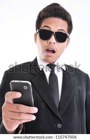 expression of a young businessman shocked with cell phone, isolated on white background - stock photo