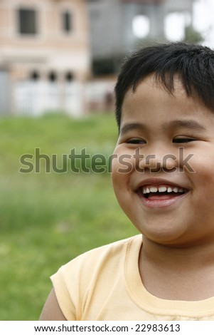 Expression of a young happy asian  boy