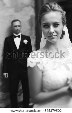 Expression of feelings, love, emotion. Newlyweds. Wedding day. Marriage. Wedding walk outdoors. Newlyweds with bouquet of flowers. Bride and groom portrait. Kiss