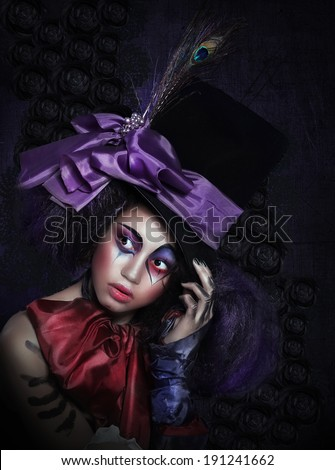 Expression. Pantomime. Clown in Fancy Carnival Hat with Artistic Makeup - stock photo