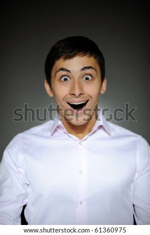 Expressions Handsome business man in funny shirt and tie surprise and laughing with open mouth - stock photo