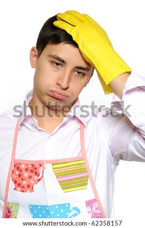 Expressions. Tired man in apron and yellow glove for washing dishes - stock photo