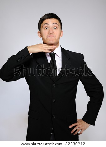 expressions - young tired business man. gray background - stock photo