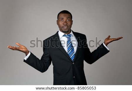 Expressive African American businessman looking puzzled and surprised.