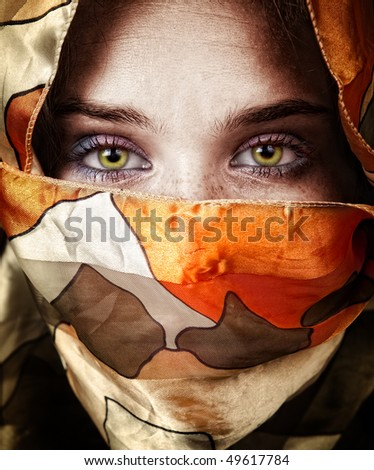 Expressive eyes of beautiful mystery sensual woman - stock photo
