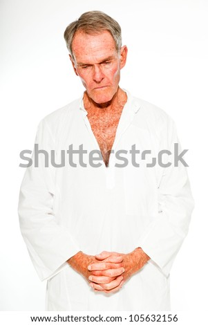 Expressive good looking senior man casual summer dressed against white wall. Spiritual and characteristic. Isolated. Studio shot. - stock photo