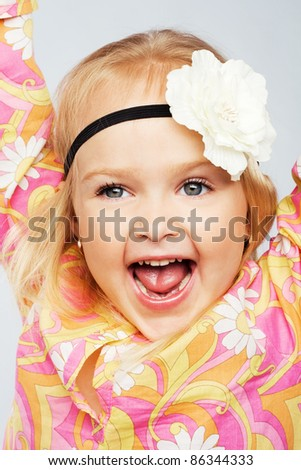 Expressive joyful little girl - stock photo