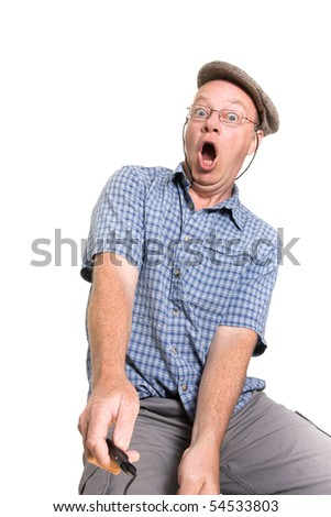 Expressive old man operating remote switch isolated against white background. - stock photo