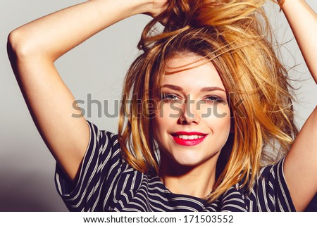 Expressive portrait of a beautiful girl, laughing - stock photo