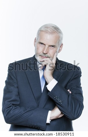 expressive portrait of a handsome senior businessman on isolated background