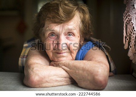 Expressive portrait of an elderly woman. - stock photo