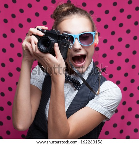 Expressive portrait of female photographer - stock photo