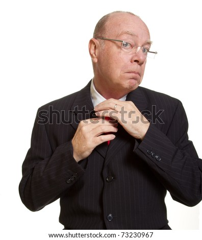 Expressive senior businessman isolated on white keeping calm and adjusting tie concept - stock photo