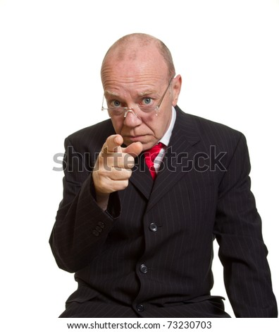 Expressive senior businessman isolated on white pointing finger concept