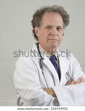 Expressive senior medical doctor/Senior Medical Doctor/Senior medical doctor dressed in white lab coat  - stock photo