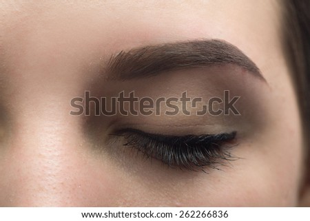 Expressive, significant eye, perfect shape of eyebrow after correction, beauty salon, pull out, have hair thinned out, care, review of the eyes, light brown coloring, natural, procedure. Young, clean - stock photo