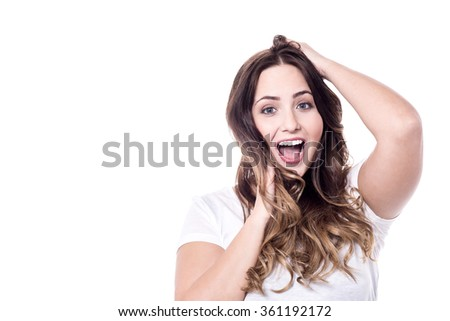 Expressive woman looking at camera over white - stock photo
