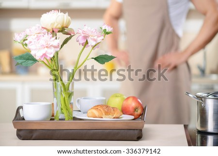 Exquisite breakfast. Wooden tray with fine healthy breakfast rests on the table.  - stock photo