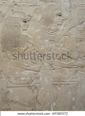 Exquisite detail of Ramose and his beautiful wife in the Tomb of Ramose in the ancient egyptian necropolis of the nobles at thebes near Luxor, Egypt - stock photo