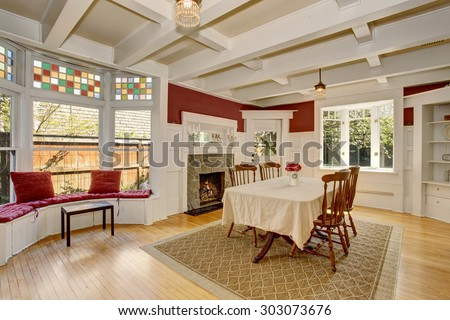 Exquisite dinning room with autumn colored decor, and white table cloth. - stock photo
