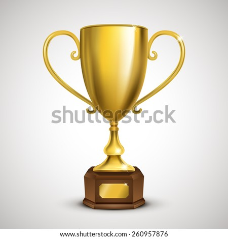 exquisite golden trophy isolated on grey background - stock photo