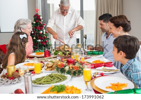 Extended family at dining table for christmas dinner in the house