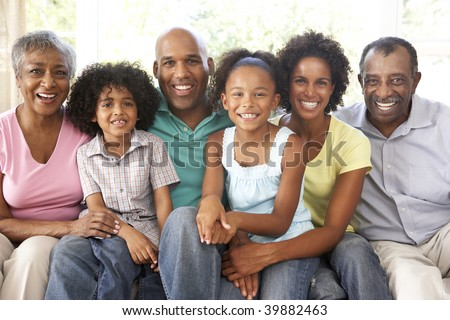 Extended Family Relaxing On Sofa At Home Together - stock photo