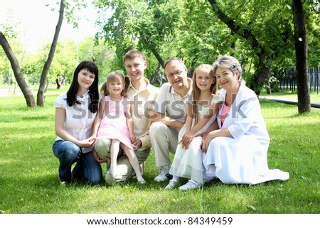 Extended family together in the summer park - stock photo