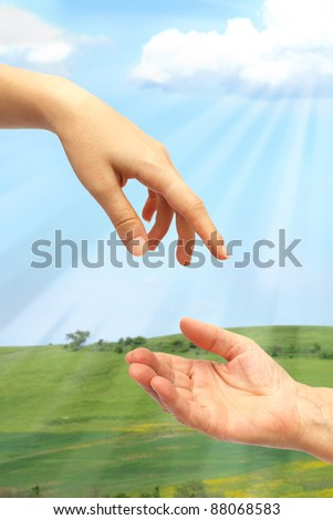Extended hand for help in nature - stock photo