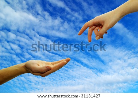 Extended hand for help on a sky background - stock photo