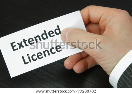 Extended Licence Sign with Human Hand - stock photo