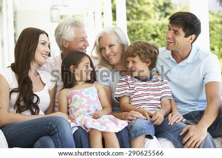 Extendend family sitting in Garden - stock photo